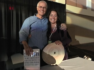 A photo of Wendy Burton meeting Paul Hawken in Palm Springs